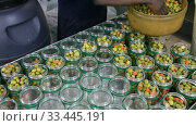 Купить «Preparing for pickling olives at food factory», видеоролик № 33445191, снято 21 ноября 2019 г. (c) Яков Филимонов / Фотобанк Лори