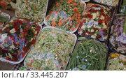 Купить «Sets of chopped vegetables wrapped in film on supermarket shelves», видеоролик № 33445207, снято 13 февраля 2020 г. (c) Яков Филимонов / Фотобанк Лори