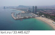Купить «Panoramic view from the drone of coastline and beach of Barcelona. Spain», видеоролик № 33445627, снято 7 июля 2019 г. (c) Яков Филимонов / Фотобанк Лори