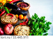 Купить «Organic food concept with variety of fresh vegetables and cereals on stone background with copy space», фото № 33445911, снято 6 апреля 2020 г. (c) age Fotostock / Фотобанк Лори