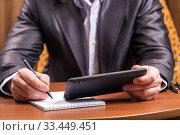 Businessman with tablet computer sitting at table. Стоковое фото, фотограф Евгений Ткачёв / Фотобанк Лори