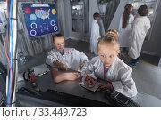 Купить «Children playing in bunker questroom», фото № 33449723, снято 21 октября 2017 г. (c) Яков Филимонов / Фотобанк Лори