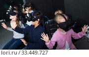 Купить «Children play virtual quest room», фото № 33449727, снято 21 октября 2017 г. (c) Яков Филимонов / Фотобанк Лори