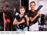 Купить «Two boys ready for lasertag game», фото № 33449771, снято 8 апреля 2020 г. (c) Яков Филимонов / Фотобанк Лори