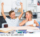 Boy is satisfied of win in board game with sister. Стоковое фото, фотограф Яков Филимонов / Фотобанк Лори
