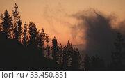 Купить «Evening landscape with clouds rising over mountains with trees», видеоролик № 33450851, снято 6 марта 2020 г. (c) Данил Руденко / Фотобанк Лори