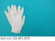 Medical surgical gloves on a blue background. World pandemic coronavirus. Health and prevention of influenza and an infectious outbreak. New Coronavirus 2019-nCoV. Стоковое фото, фотограф Tetiana Chugunova / Фотобанк Лори