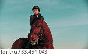 Купить «Horse riding - rider sitting on a bay horse with black mane», видеоролик № 33451043, снято 4 июня 2020 г. (c) Константин Шишкин / Фотобанк Лори