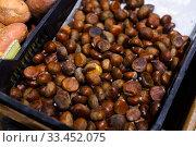 Купить «Pile of the delisious chestnuts at market place», фото № 33452075, снято 6 апреля 2020 г. (c) Яков Филимонов / Фотобанк Лори