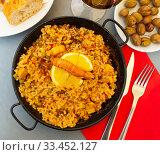 Купить «Paella with seafoods and lemon», фото № 33452127, снято 4 апреля 2020 г. (c) Яков Филимонов / Фотобанк Лори