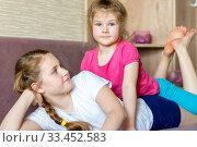 Купить «Two adorable little happy sisters are playing in their room.», фото № 33452583, снято 6 февраля 2020 г. (c) Акиньшин Владимир / Фотобанк Лори