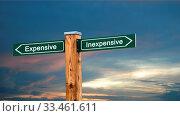 Купить «Street Sign the Direction Way to Inexpensive versus Expensive», фото № 33461611, снято 2 апреля 2020 г. (c) easy Fotostock / Фотобанк Лори