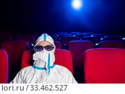 Купить «sick person cinema mask watch movie public virus», фото № 33462527, снято 23 марта 2020 г. (c) Mark Agnor / Фотобанк Лори
