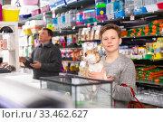 Portrait of a boy with dog in petshop, man on background. Стоковое фото, фотограф Яков Филимонов / Фотобанк Лори