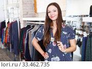 Купить «Cute girl customer posing in new fashion dress in the shop», фото № 33462735, снято 17 января 2018 г. (c) Яков Филимонов / Фотобанк Лори