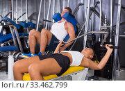 Young woman lifting weights in gym. Стоковое фото, фотограф Яков Филимонов / Фотобанк Лори
