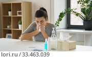 sick woman with medicine coughing to paper tissue. Стоковое видео, видеограф Syda Productions / Фотобанк Лори