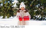Купить «happy girl with christmas gift in winter park», видеоролик № 33463131, снято 9 марта 2020 г. (c) Syda Productions / Фотобанк Лори
