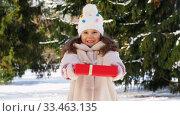 Купить «happy girl with christmas gift in winter park», видеоролик № 33463135, снято 9 марта 2020 г. (c) Syda Productions / Фотобанк Лори