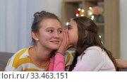 Купить «happy teenage girls gossiping at home», видеоролик № 33463151, снято 6 марта 2020 г. (c) Syda Productions / Фотобанк Лори