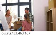 Купить «happy family with child moving to new home», видеоролик № 33463167, снято 22 марта 2020 г. (c) Syda Productions / Фотобанк Лори