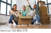 Купить «happy family playing with foam peanuts at new home», видеоролик № 33463175, снято 22 марта 2020 г. (c) Syda Productions / Фотобанк Лори