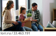 Купить «happy family with child moving to new home», видеоролик № 33463191, снято 22 марта 2020 г. (c) Syda Productions / Фотобанк Лори