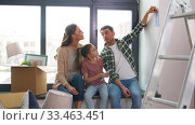 happy family with color palette moving to new home. Стоковое видео, видеограф Syda Productions / Фотобанк Лори