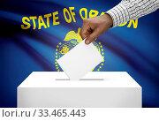 Купить «Voting concept - Ballot box with US state flag on background - Oregon», фото № 33465443, снято 1 апреля 2020 г. (c) age Fotostock / Фотобанк Лори