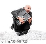 Купить «Unhappy scared or terrified businessman in depression hand holding briefcase», фото № 33468723, снято 7 августа 2019 г. (c) Илья Андриянов / Фотобанк Лори