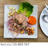 Peruvian ceviche from alaska pollock with onion and garlic. Стоковое фото, фотограф Яков Филимонов / Фотобанк Лори