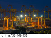 Купить «COLOMBO, SRI LANKA-FEBRUARY 22, 2020: Container terminal of the cargo port of Colombo in the evening», фото № 33469435, снято 22 февраля 2020 г. (c) Виктор Карасев / Фотобанк Лори