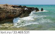 Купить «The clear water and surf waves near the rocky shore of the Ayia Thekla beach. Cyprus», видеоролик № 33469531, снято 30 марта 2020 г. (c) Serg Zastavkin / Фотобанк Лори