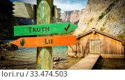 Купить «Street Sign the Direction Way to Truth versus Lie», фото № 33474503, снято 26 мая 2020 г. (c) easy Fotostock / Фотобанк Лори