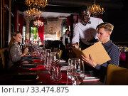 Купить «Waiter taking order from visitor», фото № 33474875, снято 6 апреля 2020 г. (c) Яков Филимонов / Фотобанк Лори