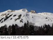 Купить «Beautiful mountains covered with snow. Sunny day and blue sky on a frosty day», фото № 33475075, снято 5 марта 2019 г. (c) Олег Хархан / Фотобанк Лори