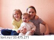Three girls of eight, seven and one-year-old. Стоковое фото, фотограф Дарья Филимонова / Фотобанк Лори