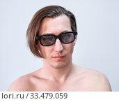 Купить «Adult Caucasian man wearing tinted glasses, naked torso, a long hair, looking at camera», фото № 33479059, снято 23 марта 2020 г. (c) Кекяляйнен Андрей / Фотобанк Лори