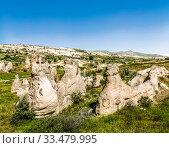 Купить «Stone pillars in the valley of the Goreme National Park. Cappadocia. Turkey», фото № 33479995, снято 13 июня 2016 г. (c) Наталья Волкова / Фотобанк Лори