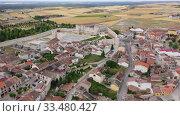 Купить «Aerial view of ancient Castle of Dukes of Alburquerque on background with Cuellar cityscape in summer day, Spain», видеоролик № 33480427, снято 20 июня 2019 г. (c) Яков Филимонов / Фотобанк Лори