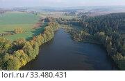 Купить «Picturesque autumn rural landscape with colorful trees by lake», видеоролик № 33480431, снято 15 октября 2019 г. (c) Яков Филимонов / Фотобанк Лори