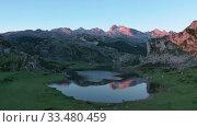 Купить «Mountain lake at sunset in Picos de Europa Natural Park. Spain», видеоролик № 33480459, снято 15 июля 2019 г. (c) Яков Филимонов / Фотобанк Лори
