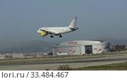 Купить «Image of Airplane of Vueling airlines approaches for landing», видеоролик № 33484467, снято 24 января 2020 г. (c) Яков Филимонов / Фотобанк Лори