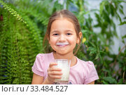 Купить «The girl drank kefir or milk from a glass and smiles. Kefir mustache», фото № 33484527, снято 1 апреля 2020 г. (c) Екатерина Кузнецова / Фотобанк Лори