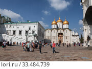 Купить «Numerous tourists on the Cathedral square in the Moscow Kremlin on a Sunny summer day. Moscow, Russia», фото № 33484739, снято 31 августа 2019 г. (c) Наталья Волкова / Фотобанк Лори