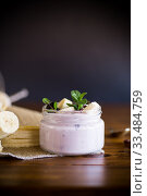 Купить «home sweet banana yogurt in a glass jar», фото № 33484759, снято 1 апреля 2020 г. (c) Peredniankina / Фотобанк Лори