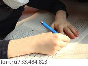 Close-up children hands with blue pen. Concept of home schooling in quarantine. Стоковое фото, фотограф Попова Ольга / Фотобанк Лори