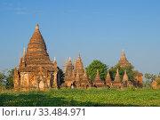 Купить «Вид на древний буддистский храмовый комплекс солнечным утром. Баган, Мьянма (Бирма)», фото № 33484971, снято 23 декабря 2016 г. (c) Виктор Карасев / Фотобанк Лори