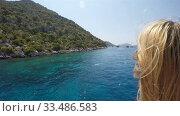 Купить «a girl admires the sea and sights from the deck of a floating sea vessel», видеоролик № 33486583, снято 26 ноября 2019 г. (c) Aleksandr Sulimov / Фотобанк Лори