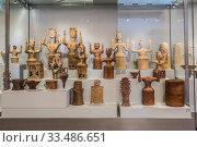 Купить «Clay figures of goddesses with raised hands of the Minoan civilization in the archaeological Museum of Heraklion. Crete, Greece», фото № 33486651, снято 5 июня 2017 г. (c) Наталья Волкова / Фотобанк Лори